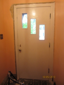 "Interior view of the front door. Say ""bye, bye"" paint!"
