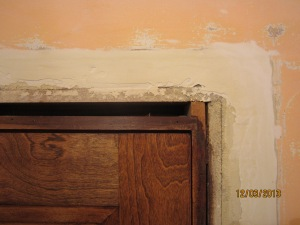 Plaster repair above the closet door.