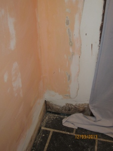 Wall repair by the front door.